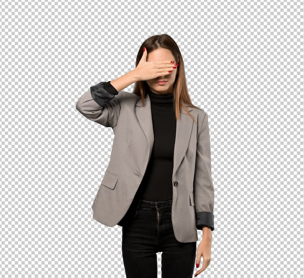 Business woman covering eyes by hands. do not want to see something