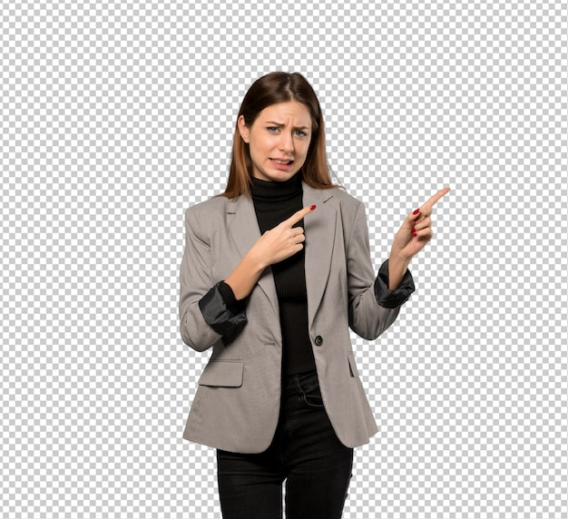 Business woman frightened and pointing to the side