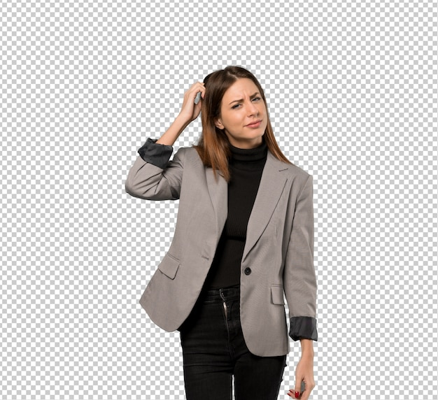 Business woman having doubts while scratching head