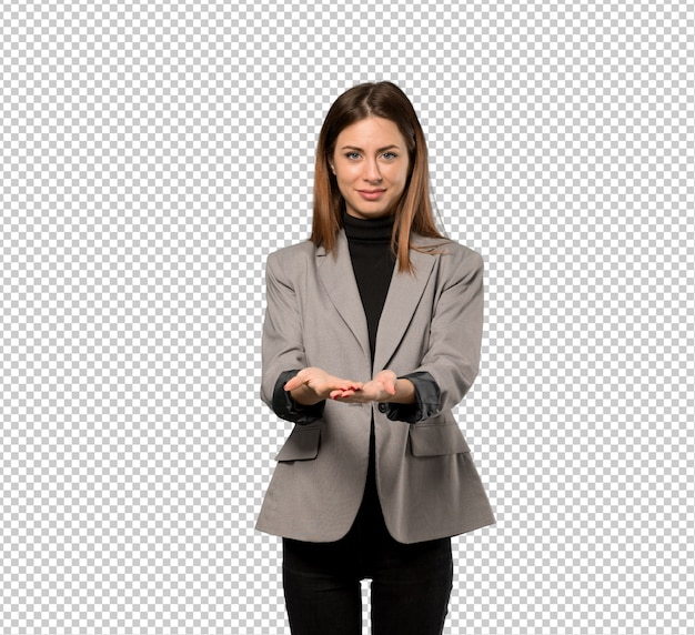 Business woman holding copyspace imaginary on the palm to insert an ad