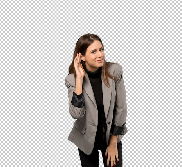 Business woman listening to something by putting hand on the ear