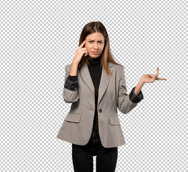 Business woman making the gesture of madness putting finger on the head