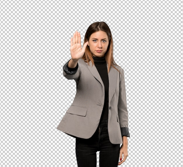 Business woman making stop gesture denying a situation that thinks wrong