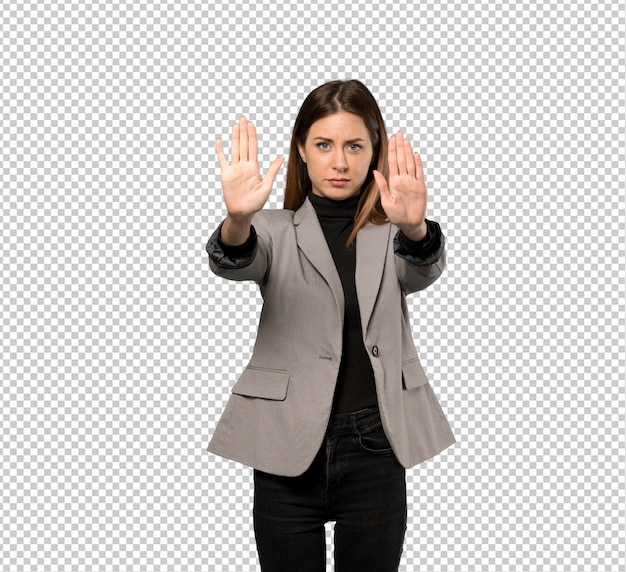 Business woman making stop gesture and disappointed
