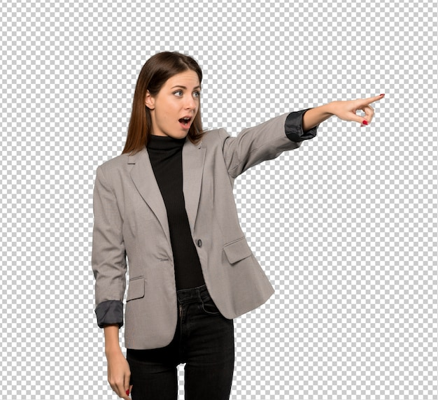 Business woman pointing away