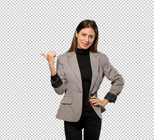 Business woman pointing to the side to present a product