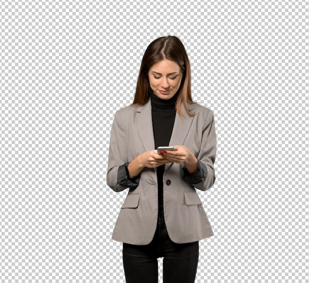 Business woman sending a message with the mobile