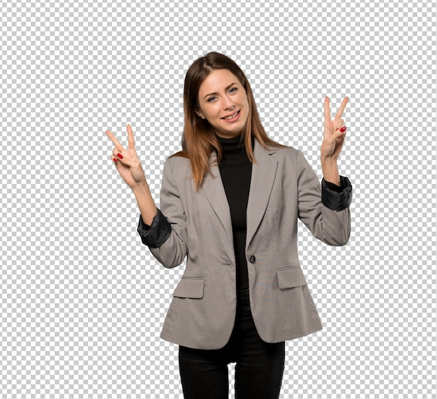 Business woman smiling and showing victory sign with both hands