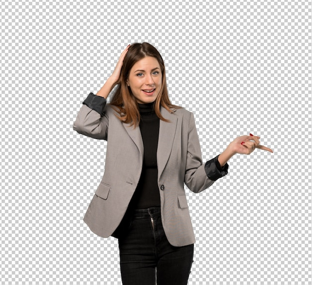 Business woman surprised and pointing finger to the side