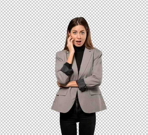 Business woman surprised and shocked while looking right
