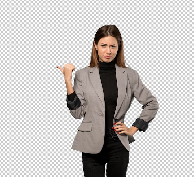 Business woman unhappy and pointing to the side
