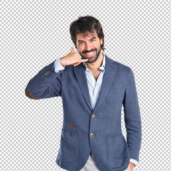 Businessman doing phone gesture over white background