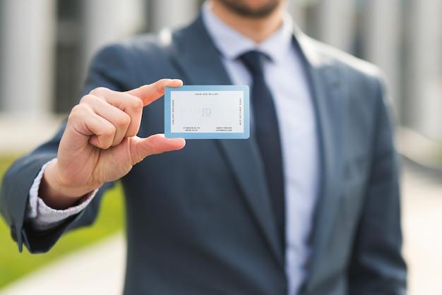 Businessman holding business card mockup