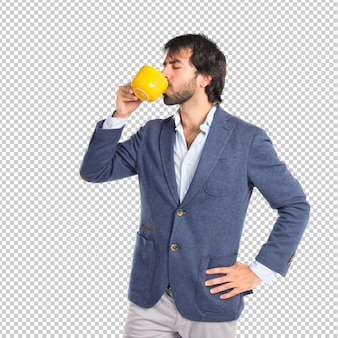 Businessman holding a cup of coffee over white background
