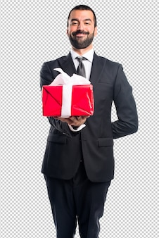 Businessman holding a gift