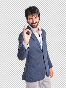 Businessman making ok sign over white background