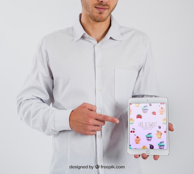 Businessman pointing at tablet