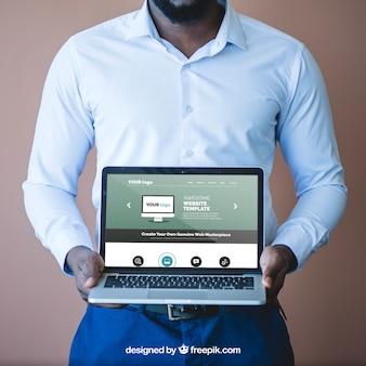 Businessman presenting laptop