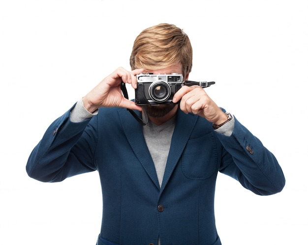 Businessman taking a picture with a vintage camera
