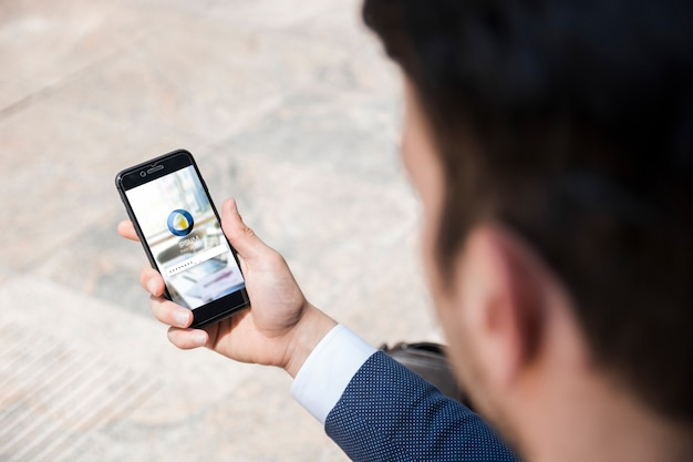 Businessman using smartphone mockup