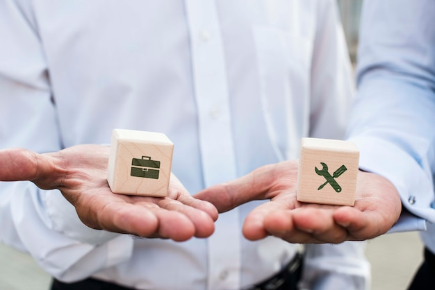 Businessmen holding dices with company ideas