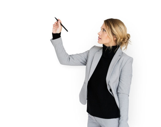 Businesswoman writing in the air