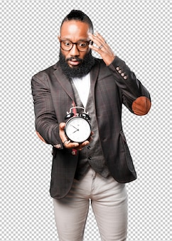Bussines black man holding an alarm clock
