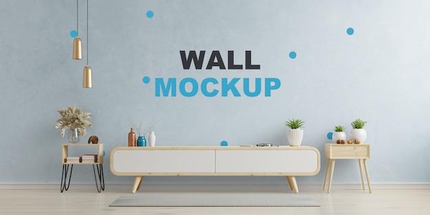 青い壁のリビングルームのテレビ用キャビネットと壁、3dレンダリング