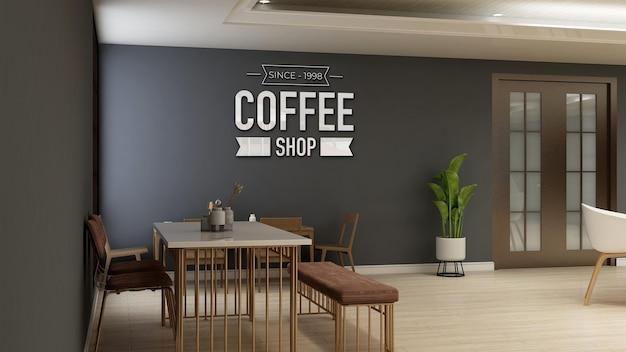 Макет логотипа кафе или ресторана в кофейне со столом и письменным столом