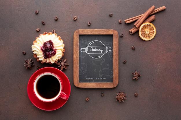 Cake with cinnamon black coffee and blackboard mockup