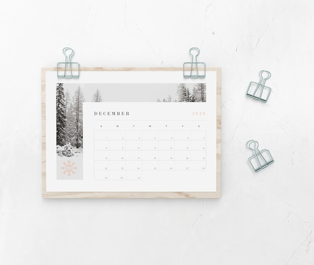 Calendar catched on wooden board