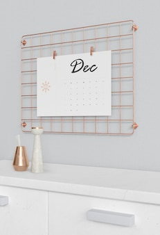 Calendar hooked on squared metal support