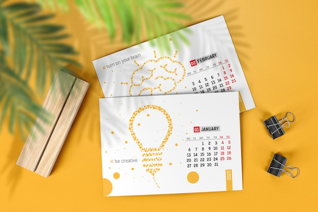 Calendar pages with wooden stand and clips mockup