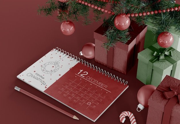 Calendar with christmas ornaments mockup Premium Psd