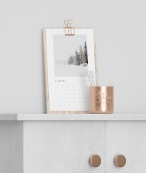 Calendar on wooden board on cabinet