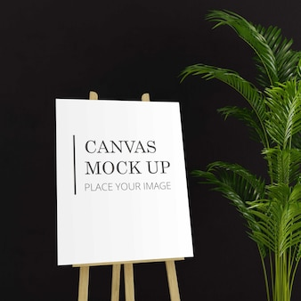 Canvas mock up with plant on a easel