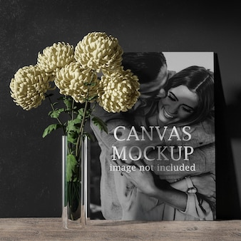 Canvas mockup behind yellow flower
