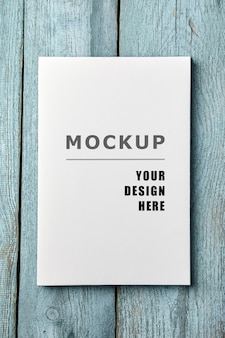 Canvas print mockup on old light blue wooden surface