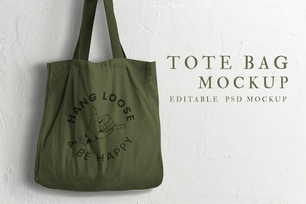 Canvas tote bag mockup psd with rock on hand logo