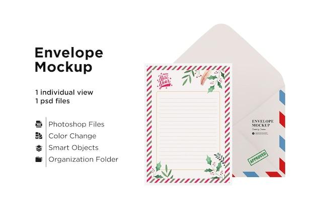 クリスマスコンセプトのカードと封筒のモックアップ