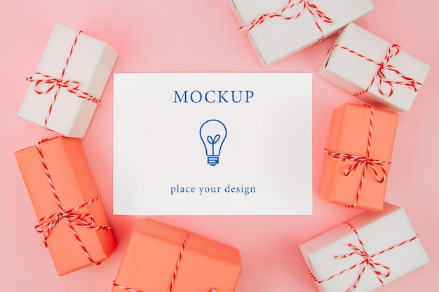 Card and boxes with gifts on a pink background, mockup