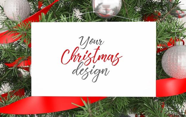 Card hanging on christmas tree mockup