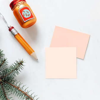 Card mockups with baubles on white marble background