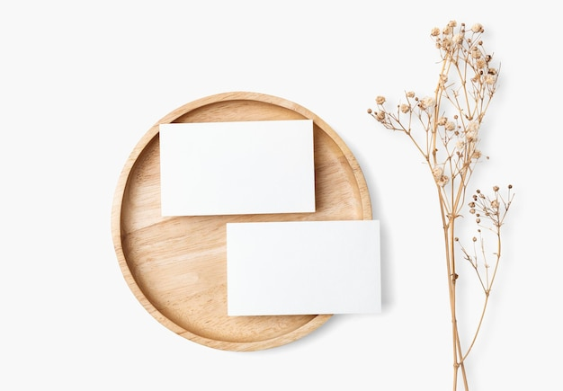 Card psd mockup on wooden plate in flat lay style