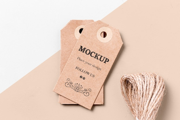 Cardboard mock-up clothing labels and thread