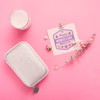 Cardboard mock-up with candle on pink background