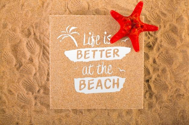 Cardboard mockup on sand