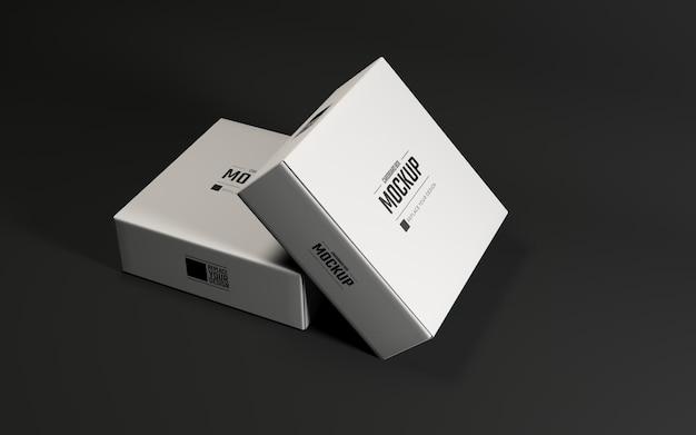 黒の背景を持つ段ボールの白いパッケージのモックアップデザイン