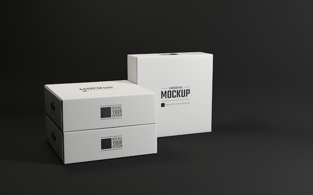 黒の背景を持つ段ボールの白いパッケージのモックアップ