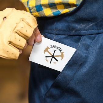 Carpenter holding business card mockup